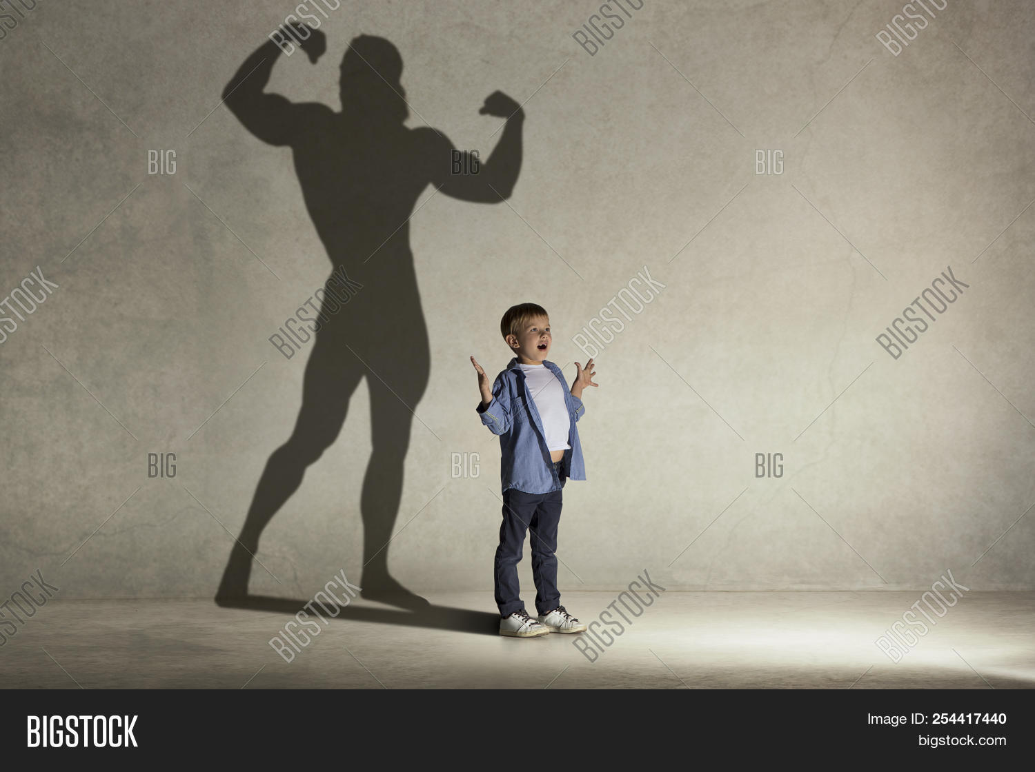 Conceptual,athlete,athletic,baby,become,bodybuilder,boy,champ,child,childhood,concept,creativity,doodles,dream,dreaming,equipment,famous,fantasy,fast,figure,fit,foot,full,fun,game,hero,high,idea,imagination,innocent,kid,lifestyle,light,little,male,muscles,people,performance,person,player,room,school,shadow,sport,studio,success,super,wall,young,youth