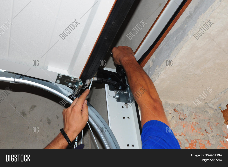 bolt,built,door,garage,goor,hands,home,house,installation,installing,interior,modern,opener,renovate,repair,repairman,replacement,residential,roller,seals,springs
