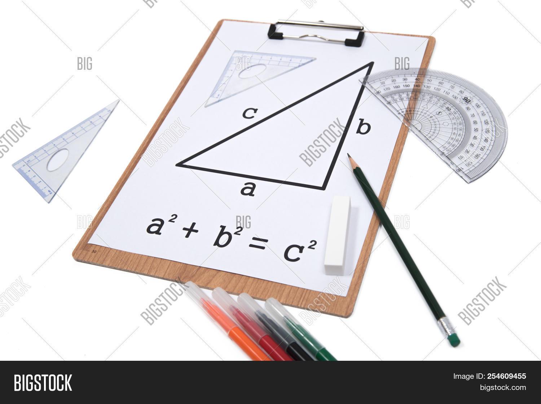 Pythagorean Theorem. Clipboard Triangle Protractor Pencil Isolat
