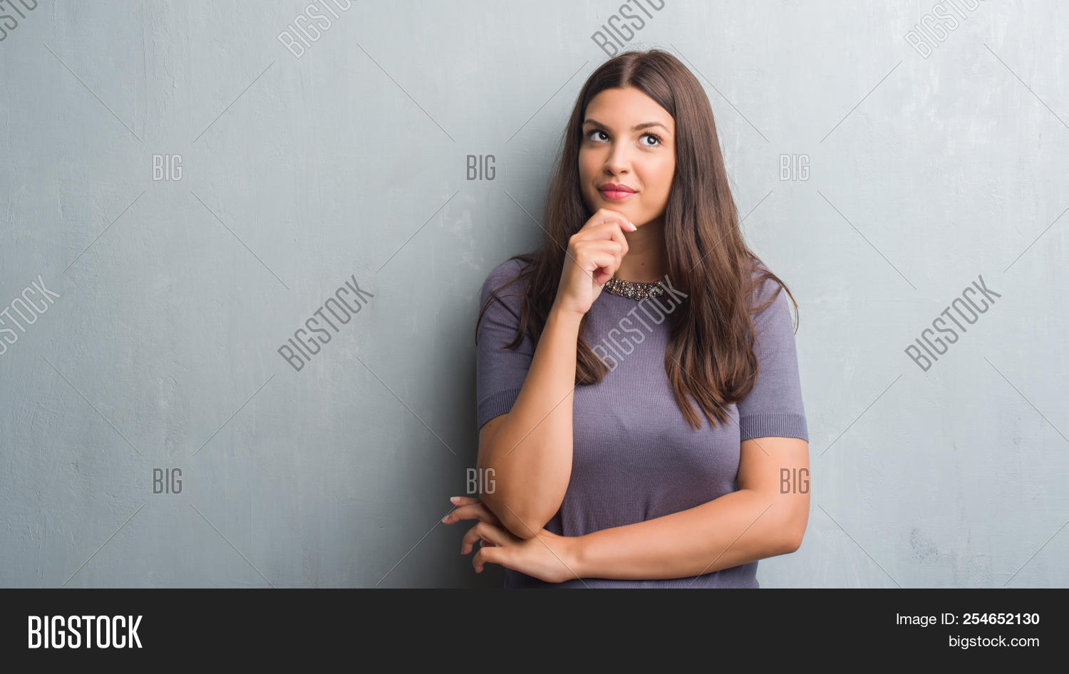 background,belief,brain,brunette,chin,concentration,concept,confident,confused,consider,convinced,cool,doubt,elegant,expression,face,fashion,female,girl,grey,grunge,hand,hispanic,idea,indoors,latin,long hair,looking,model,natural,one,opinion,pensive,perfect,question,reason,reasoning,serious,studio,success,think,thinking,thought,thoughtful,trust,up,wall,woman,wonder,young