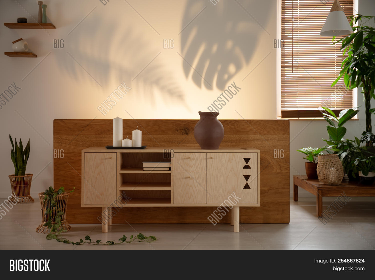 🔥 Candles On Wooden Cupboard In Bedroom Interior With Plants And