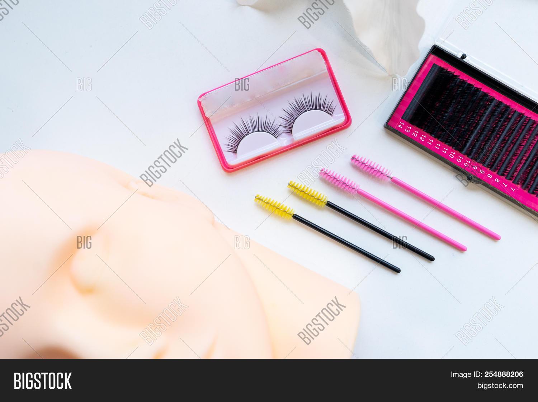 Top View Eyelash Extension Tools On White Background Brush Lash