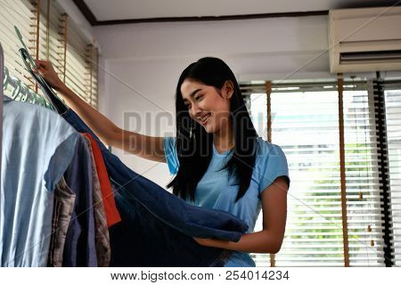 Shopping concept. Asian girls are enjoying shopping. Asian girls are trying their favorite clothes. stock photo