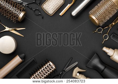 Hairdresser tools on black background with copy space in center stock photo