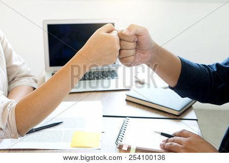 two business man woman use hand to fist bump for succes teamwork coporate stock photo