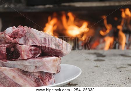 Raw steaks fiorentina-style, typical of Tuscany, Italy, ready to be cooked in a wood burning oven stock photo