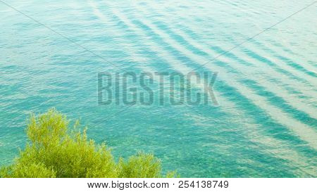 Beautiful water of Lake Ohrid as nature background. Ohrid is the oldest lake in Europe. Mediterranean nature, copy space. stock photo