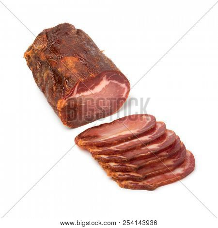 Piece of spanish Lomo Embuchado meat and slices isolated on white background stock photo
