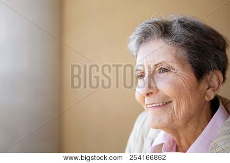 Portrait of a mature elderly woman smiling. stock photo