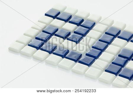 little blue ceramic tile on a white background, majolica. for the catalog stock photo