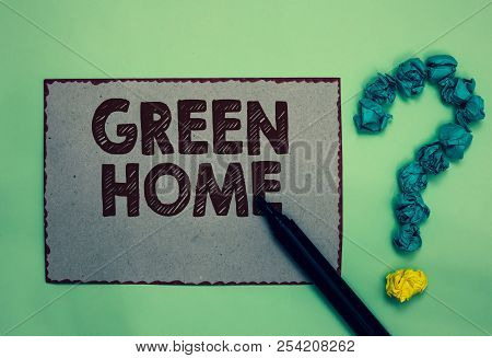Word writing text Green Home. Business concept for An area filled with plants and trees where you can relax Gray paper marker crumpled papers forming question mark green background. stock photo