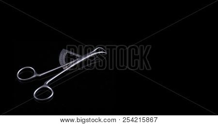 Dental caliper on black background. This instrument has calibrated scale and is used to measure the size of teeth. Closeup stock photo