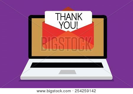 Handwriting text writing Thank You. Concept meaning replaying on something good or greetings with pleased way Computer receiving email important message envelope with paper virtual. stock photo