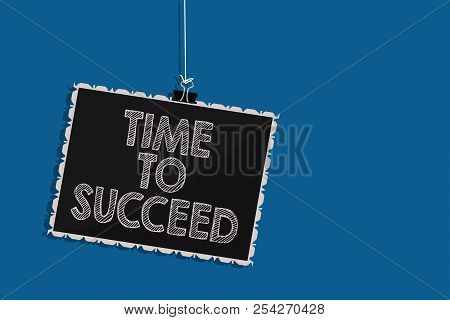 Writing note showing Time To Succeed. Business photo showcasing Thriumph opportunity Success Achievement Achieve your goals Hanging blackboard message communication information blue background. stock photo