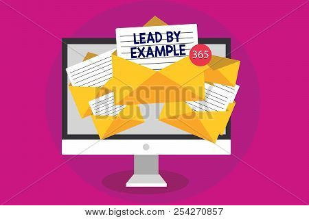Handwriting text writing Lead By Example. Concept meaning Be a mentor leader follow the rules give examples Coach Computer receiving emails important messages envelopes with papers virtual. stock photo