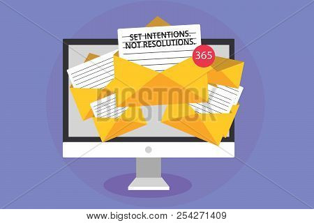 Word writing text Set Intentions. Not Resolutions.. Business concept for Positive choices for new start achieve goals Computer receiving emails important messages envelopes with papers virtual. stock photo