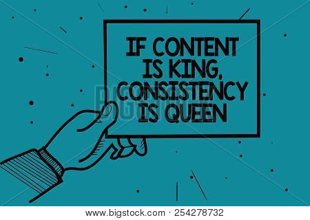 Writing note showing If Content Is King, Consistency Is Queen. Business photo showcasing Marketing strategies Persuasion Man hand holding paper communicating dotted turquoise background. stock photo