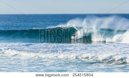 Surfer unidentified head under water falling crashing wipe out attemped ocean wave ride. stock photo