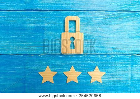 Wooden padlocks and three stars. Security, security of users and business. Internet security, antivirus, data protection. Alarms of home, car and business. The concept of property protection. stock photo