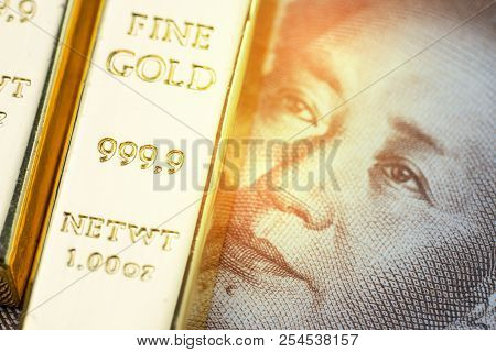China national gold reserve concept, shiny gold bar bullion ingot on Chinese yuan banknote money with shiny golden flare light, country financial asset or safe haven investment in stock crisis. stock photo