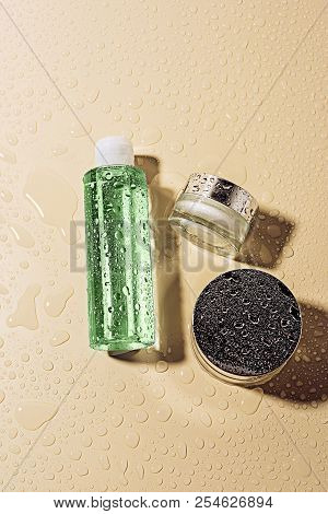 top view of micellar water and body creams on beige background stock photo