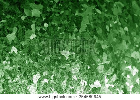 Metal surface with scratches in green tone. Abstract background and texture for design. stock photo
