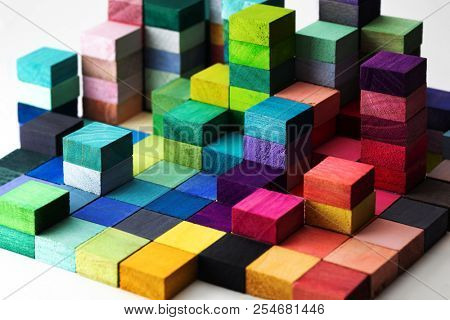Spectrum of stacked multi-colored wooden blocks. Background or cover for something creative, diverse