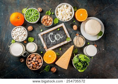 Healthy food concept. Set of food rich in calcium - dairy and vegan Ca products, dark blue background copy space  top view stock photo