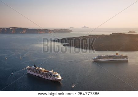 Beautiful landscape with sea view on the Sunset. Cruise liner in the Aegean Sea, Thira, Santorini island, Greece. Summer seascape overlooking the blue sea, caldera and volcano, travel concept. stock photo