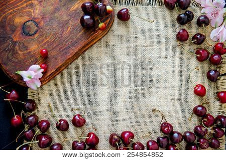 Homemade cinnamon buns in glaze on a dark plate with berries stock photo