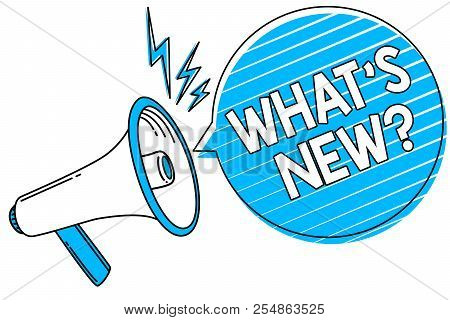 Word writing text What s is New question. Business concept for Asking about latest Updates Trends Happening News Megaphone loudspeaker blue speech bubble stripes important loud message. stock photo