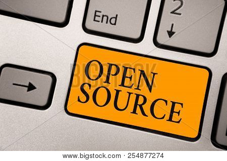 Handwriting text Open Source. Concept meaning denoting software which original source code freely available Keyboard orange key Intention create computer computing reflection document. stock photo