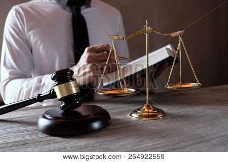 Male lawyer working with lawsuit papers on tabel in courtroom. justice process and law, attorney, court judge, concept. stock photo