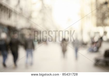 conceptual obscured foundation of individuals strolling in city