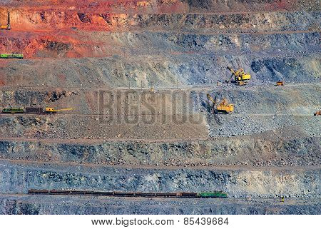 iron ore open pit mining quarry red gray brown stock photo