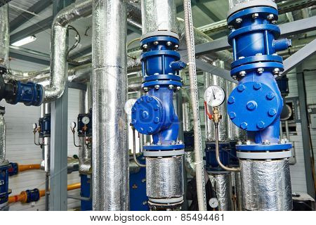 Closeup of manometer, pipes and faucet valves of gas heating system in a boiler room stock photo