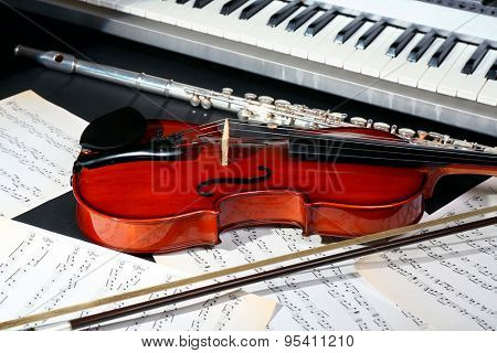 Musical instruments with music notes on dark background stock photo
