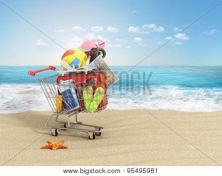 Shopping cart with beach accessories on the beach line. Summer shopping. Sunbed sunglass world map