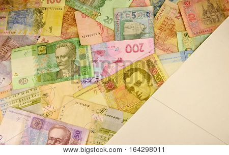 Background image of many Ukrainian banknotes of different colors and size. Conceptual image for the Ukrainian banking operations withdraw funds wealth and possession of huge sums of money in Ukraine stock photo