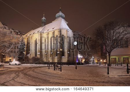 Monastery of St. Agnes Czech night view iwith snow in Prague first Gothic building in Bohemia about the year 1230 today there is the National Gallery stock photo