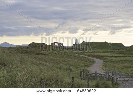 Llanddwyn Island, Lighthouse in the distance peninsula on Anglesey. Newborough,, Wales, United Kingdom stock photo
