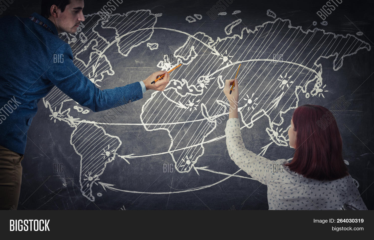 Man And Woman Sharing Thoughts Together Drawing A World Map On A Blackboard. Future Journey Planning