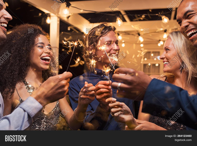 20s,bengal light,celebrate,celebrating,celebration,celebration party,elegant woman,enjoyment,entertainment,eve,event,festive,fire,firework,fireworks,fireworks stars,friends,friendship,girl,girls,glamour,glowing,greeting,group,guy,guys,happy,having fun,joy,laughing,light,man,multi ethnic group,multiethnic,new year party,new year's eve,night,night life,nightlife,outdoor,party,party night,people,smiling,sparkler,sparklers,together,woman,year,young