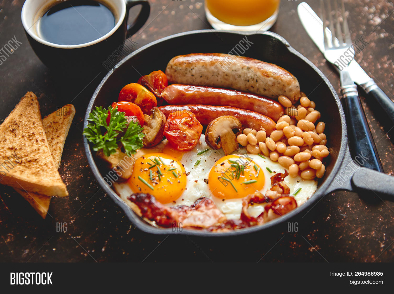 background,bacon,baked,bean,bread,breakfast,butter,cholesterol,closeup,coffee,cooked,cooking,cuisine,delicious,dinner,dish,egg,eggs,english,fat,flat lay,food,fork,fresh,freshness,fried,fried egg,frying pan,full,healthy,knife,meal,meat,morning,mushroom,orange,pan,plate,roasted,sausage,serving size,stone,table,toast,tomato,top,traditional,view,wooden,yolk
