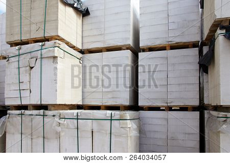 New aerated concrete blocks on pallets stored at warehouse stock photo
