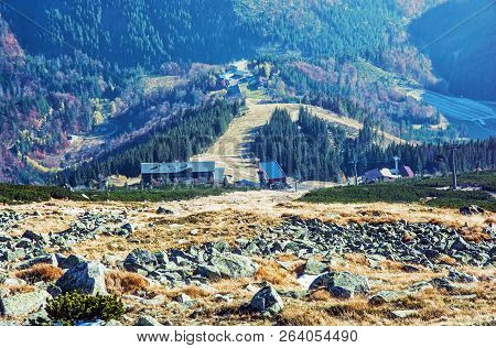 Lift station in Low Tatras mountains. Cable car to the Chopok peak, Slovakia. Valley with coniferous forest. Natural scene. Travelling theme. Vivid photo filter. stock photo