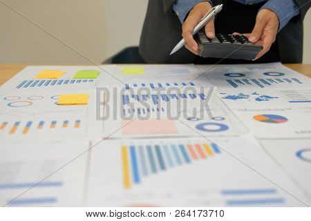 financial adviser working with calculator at office. accountant doing accounting & calculating revenue & budget. bookkeeper making calculation. finance & economy concept stock photo