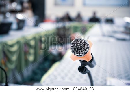 Microphones On Abstract Blurred Of Speech In Seminar Room Or Front Speaking Conference Hall Light, B