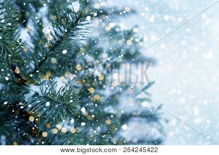 Closeup Of Christmas Tree With Light, Snow Flake. Christmas And New Year Holiday Background. Vintage