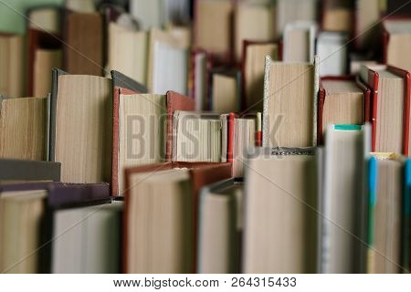 Stack Of Books Background. Many Books Piles. Stack Of Books Of Different Thickness And Color, Many B
